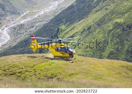 Pitztal - August 6: Emergency rescue helicopter near lake Rifflsee in the Pitztal in Austria on August 6, 2013 - stock photo