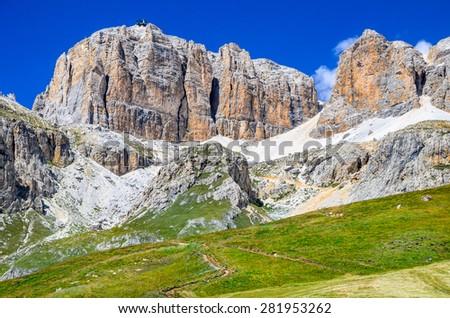 Piz Pordoi, Val di Fassa, Sella Dolomites in Italy. Sass Pordoi south face (2952 m) in Gruppo del Sella, Dolomites mountains in Alps - stock photo