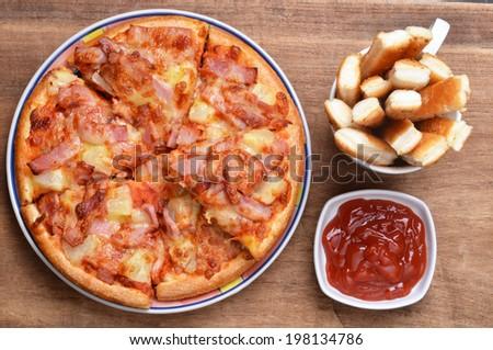 Pizza and bread stick - stock photo