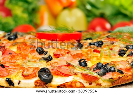 pizza and fresh vegetables