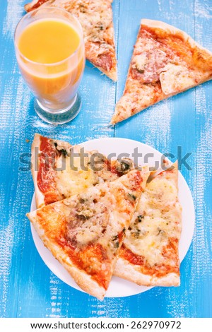 Pizza and juice. - stock photo