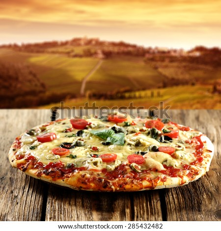 pizza and wooden table place  - stock photo