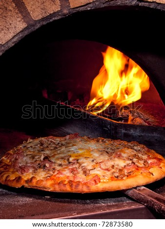 Pizza baking in the oven - stock photo