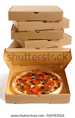 Pizza box open, pepperoni pizza inside, delivery boxes stacked in background - stock photo