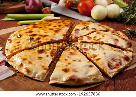 Pizza Calzone with Minced Meat and Onions - stock photo