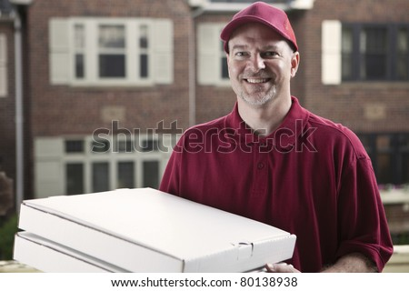 Pizza delivery guy - stock photo