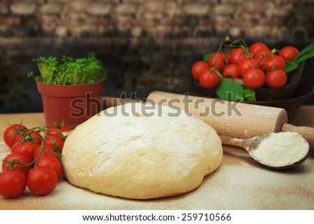Pizza dough. - stock photo