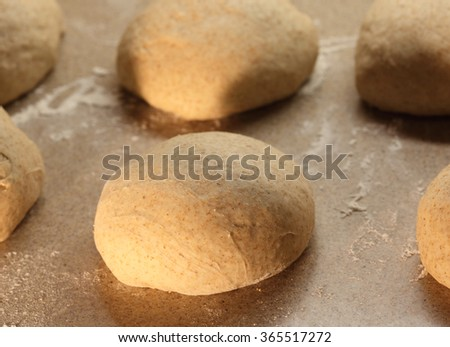 Pizza dough rising by the fire - stock photo