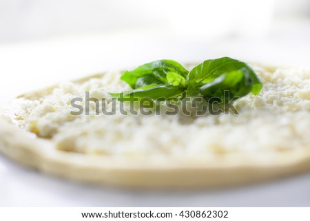 pizza dough with mozzarella cheese oil and basil