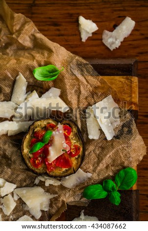 pizza eggplant with tomatoes and basil and parmesan cheese , selective focus - stock photo