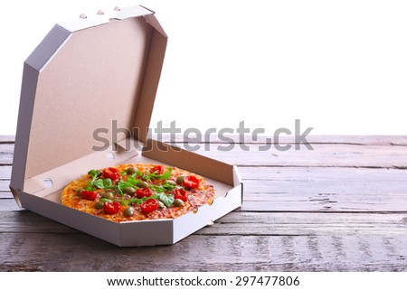 Pizza in box on wooden table isolated on white - stock photo