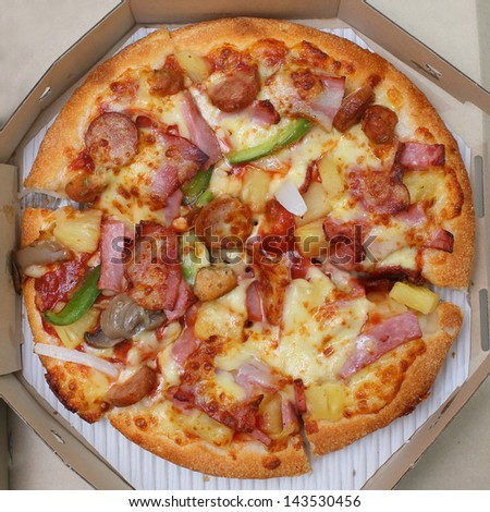 pizza in box, top view - stock photo