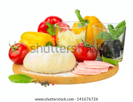 Pizza ingredients - dough, ham, tomato, cheese, olives pepper and basil - stock photo