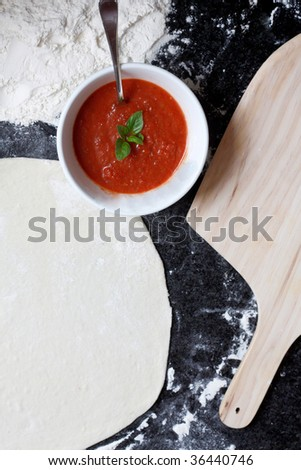 Pizza ingredients on a counter top - stock photo