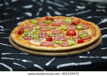 Pizza. Kitchen. Sausage pizza - stock photo