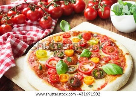 Pizza Margherita / fresh homemade tomato pizza - stock photo
