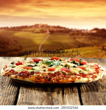 pizza on board and summer sunset  - stock photo