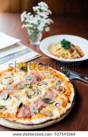 Pizza on wood table