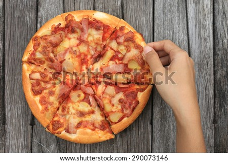 pizza on wooden table background
