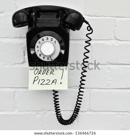 Pizza ordering reminder note - stock photo