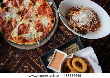 pizza pasta and onion ring on top view