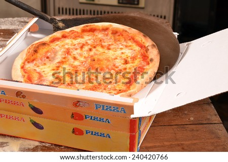 Pizza ready for delivery. - stock photo