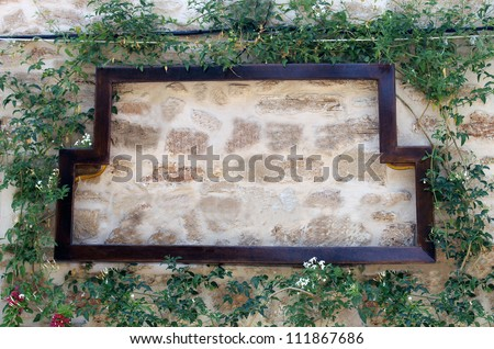 Pizza restuaurant sign on old wall surrounded by ivy, Italian or Spanish with copy space. - stock photo