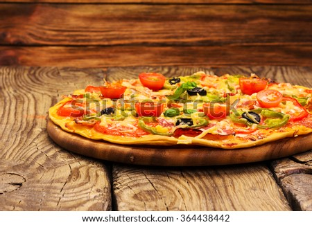 pizza served on wooden table