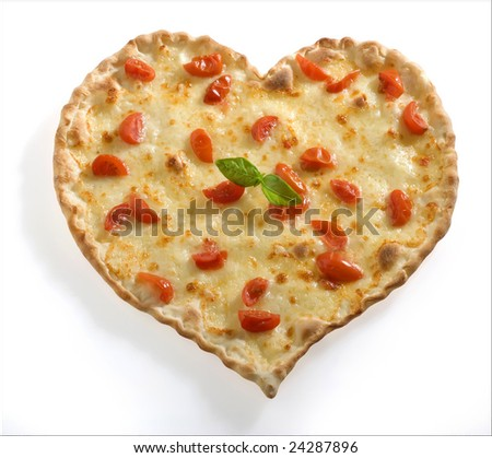 Pizza-shaped heart with fresh tomato - stock photo