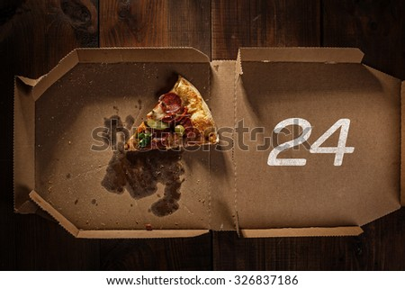 pizza slice in the in delivery box with 24 time text on the wood - stock photo