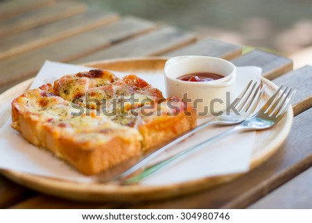 Pizza toasted bread with tomato sauce and ham cheese selective focus - vintage style effect picture - stock photo
