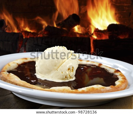 Pizza topped with ice cream with chocolate - stock photo