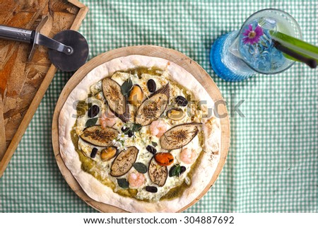 Pizza with a cutter. Top view. - stock photo