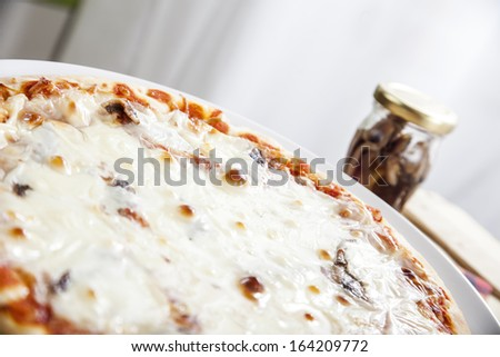 Pizza with cheese and anchovies