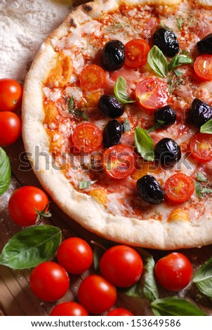 pizza with cherry tomatoes and black olives