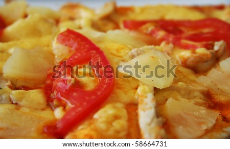 Pizza with chiken, tomatoes and pineapple - stock photo