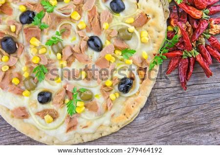 Pizza with corn, tuna, onions , olives - stock photo