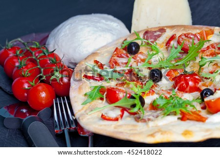 Pizza with dry cured ham and arugula. Pizza background. - stock photo