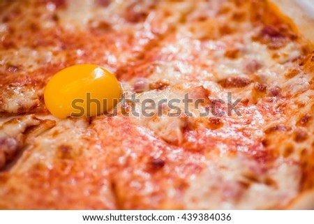 Pizza with egg yolk close up - stock photo