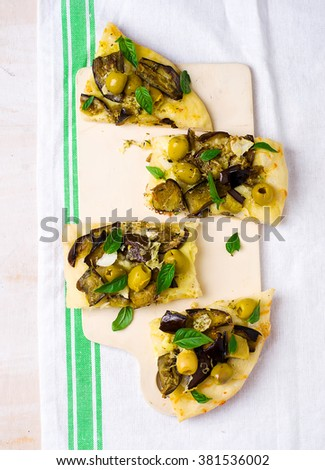 pizza with eggplant  cut with pieces. selective focus - stock photo