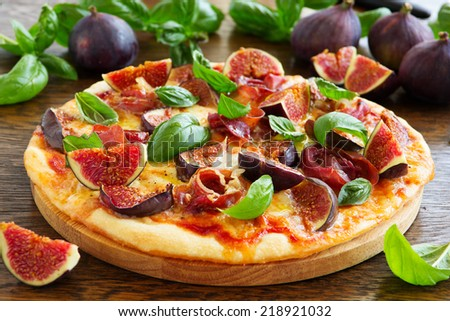 Pizza with figs, prosciutto and mozzarella. - stock photo