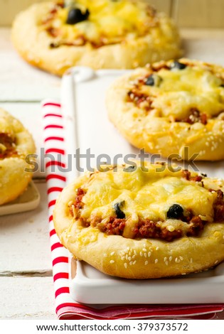 pizza with ground meet and cheese. selective focus - stock photo