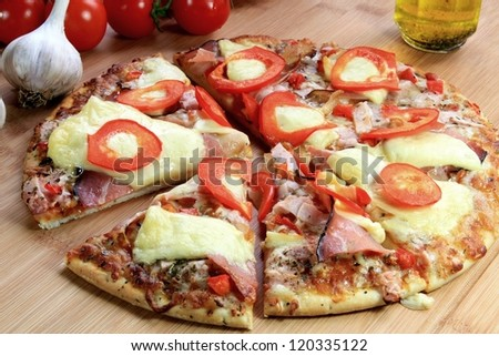 Pizza with ham, cheese  and pepper - stock photo