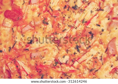Pizza with ham, onions, cheese and herbs as food background or t - stock photo