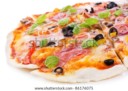 pizza with ham, salami and vegetables on white background