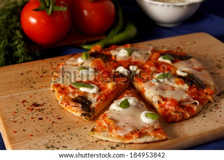 Pizza with mozerella cheese and broccoli and tomatoe souce