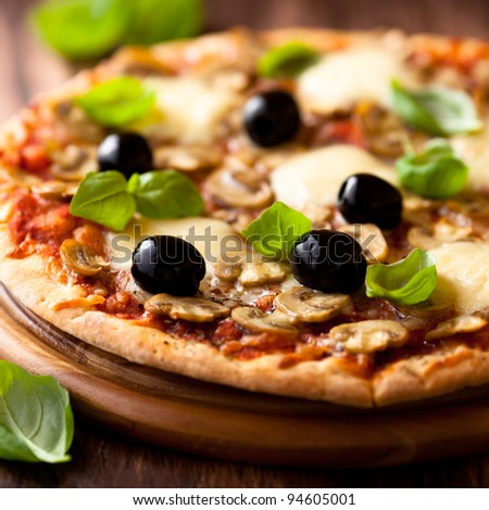 Pizza with mozzarella and mushrooms - stock photo