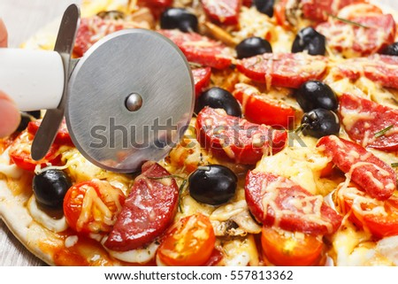 Pizza with Mozzarella Cheese, Fresh Tomato and Mushrooms on wooden table.