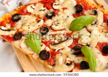 Pizza with mushrooms and cheese - stock photo