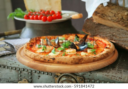 pizza with mussels, and fresh basil